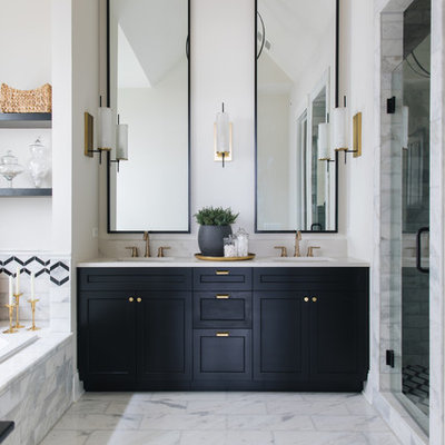 Bathroom - country white tile white floor bathroom idea in Chicago with recessed-panel cabinets, black cabinets, white walls, an undermount sink, a hinged shower door and white countertops