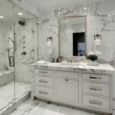 Inspiration for a mid-sized timeless master white tile and stone tile marble floor alcove shower remodel in Chicago with an undermount sink, white cabinets, marble countertops, raised-panel cabinets, a one-piece toilet and white walls