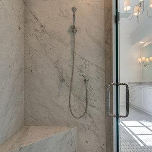 Cette photo montre une grand salle de bain principale chic avec des portes de placard blanches, une baignoire indépendante, une douche à l'italienne, un mur blanc, un sol en marbre, un lavabo encastré, un sol jaune, une cabine de douche à porte battante et un plan de toilette blanc.
