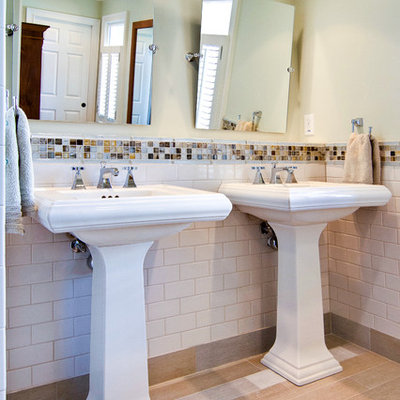 Example of a trendy white tile and subway tile bathroom design in Atlanta with a pedestal sink