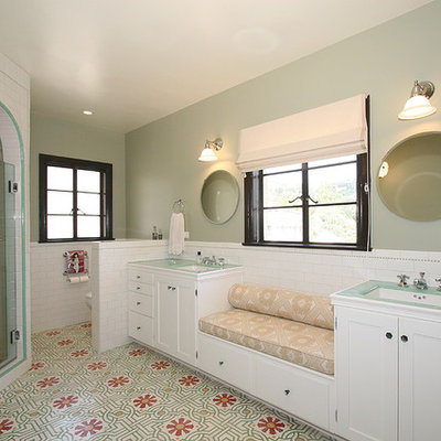 Example of a classic subway tile bathroom design in Los Angeles with tile countertops and green countertops