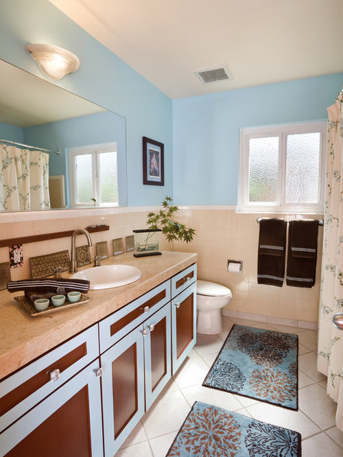 trendy beige tile shower curtain photo in san francisco with a drop in sink