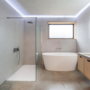 this is an example of a medium sized modern ensuite bathroom in london with flat - Modern Bathroom Ideas