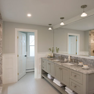 Example of a mid-sized beach style master porcelain tile, multicolored floor, double-sink and wainscoting bathroom design in Boston with furniture-like cabinets, gray cabinets, a two-piece toilet, multicolored walls, an undermount sink, quartzite countertops, a hinged shower door, gray countertops and a built-in vanity
