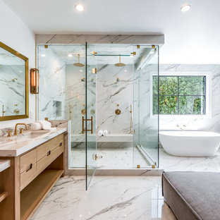 Inspiration for a transitional 3/4 bathroom remodel in Los Angeles with flat-panel cabinets, light wood cabinets, white walls, an undermount sink, a hinged shower door and gray countertops