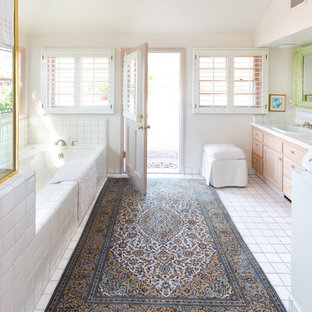 Elegant white tile ceramic tile bathroom photo in Los Angeles with beige walls and tile countertops