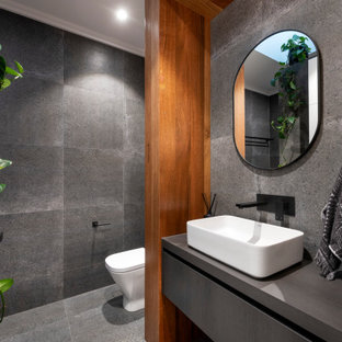 This is an example of a mid-sized contemporary 3/4 bathroom in Perth with flat-panel cabinets, grey cabinets, gray tile, a vessel sink, grey floor and grey benchtops.