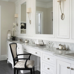 Bathroom - large traditional master gray tile dark wood floor bathroom idea in Other with recessed-panel cabinets, white cabinets, marble countertops, white walls and an undermount sink