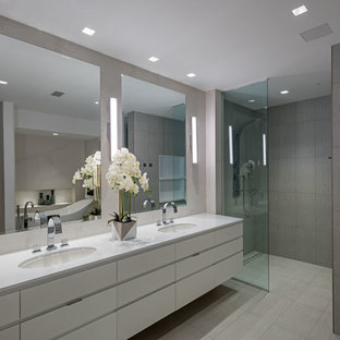 Contemporary ensuite bathroom in Seattle with flat-panel cabinets, white cabinets, a built-in shower, grey tiles, a submerged sink, grey floors and an open shower.