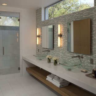 Example of a large trendy master green tile, white tile and glass tile ceramic floor alcove shower design in Austin with a vessel sink, white walls, open cabinets, medium tone wood cabinets and engineered quartz countertops