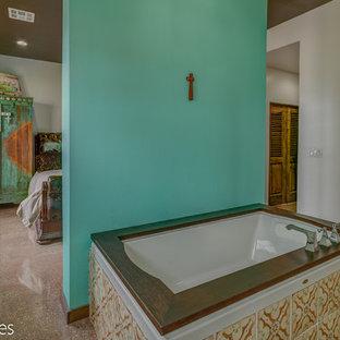 Imagen de cuarto de baño principal, campestre, con armarios con paneles empotrados, puertas de armario de madera en tonos medios, bañera encastrada, ducha empotrada, baldosas y/o azulejos multicolor, baldosas y/o azulejos de terracota y encimera de cemento