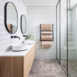 Inspiration for a scandinavian 3/4 bathroom in Sydney with flat-panel cabinets, light wood cabinets, a curbless shower, white tile, a vessel sink, grey floor, an open shower and white benchtops.