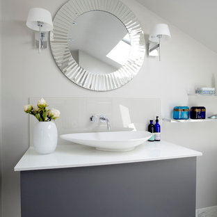Bathroom - contemporary bathroom idea in London with a vessel sink and gray cabinets