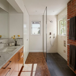 Bathroom - contemporary 3/4 white tile and subway tile medium tone wood floor and brown floor bathroom idea in San Francisco with flat-panel cabinets, medium tone wood cabinets, white walls, an undermount sink and gray countertops