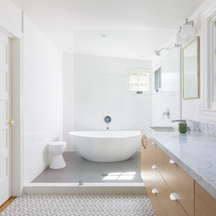 Transitional master white tile multicolored floor bathroom photo in San Francisco with flat-panel cabinets, medium tone wood cabinets, white walls, an undermount sink and gray countertops
