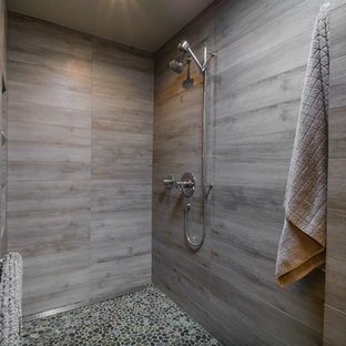 Inspiration for a mid-sized modern master gray tile and porcelain tile pebble tile floor bathroom remodel in Los Angeles with flat-panel cabinets, medium tone wood cabinets, gray walls and quartz countertops