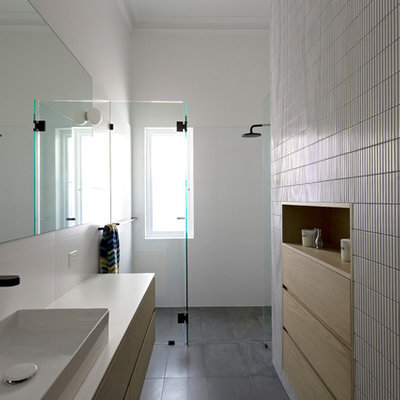 Inspiration for a contemporary 3/4 white tile and mosaic tile slate floor and gray floor walk-in shower remodel in Perth with light wood cabinets, white walls, a vessel sink, a hinged shower door, white countertops and flat-panel cabinets
