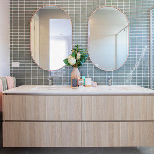 This is an example of a mid-sized contemporary master bathroom in Melbourne with light wood cabinets, green tile, ceramic tile, ceramic floors, an undermount sink, engineered quartz benchtops, white benchtops, flat-panel cabinets and grey floor.
