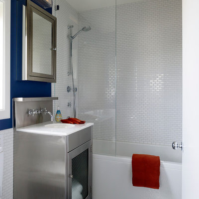 Trendy white tile bathroom photo in San Francisco with an undermount sink and glass-front cabinets