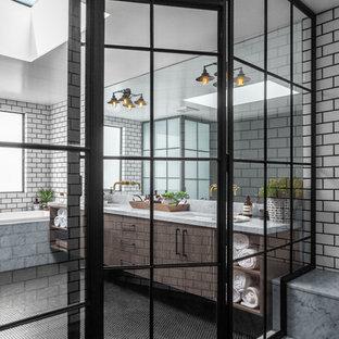 Идея дизайна: большая главная ванная комната в стиле лофт с фасадами с выступающей филенкой, светлыми деревянными фасадами, накладной ванной, душевой комнатой, унитазом-моноблоком, черно-белой плиткой, керамогранитной плиткой, черными стенами, накладной раковиной, мраморной столешницей, черным полом, душем с распашными дверями, серой столешницей и полом из керамической плитки
