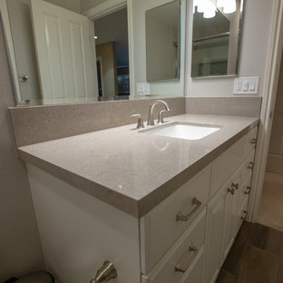 Inspiration for a modern gray tile and ceramic tile porcelain floor and brown floor bathroom remodel in Sacramento with white cabinets, gray walls, an undermount sink, engineered quartz countertops and gray countertops