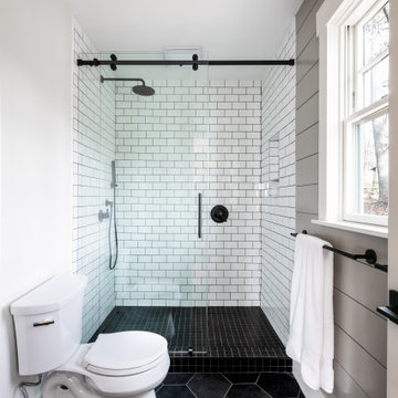 Classic black and white master bathroom with antique vanity