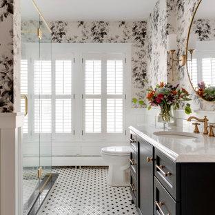 Idées déco pour une grand salle de bain principale classique avec des portes de placard noires, un sol en carrelage de porcelaine, un lavabo encastré, une cabine de douche à porte battante, un plan de toilette blanc, un placard à porte shaker, une douche d'angle, un WC séparé, un mur multicolore, un sol multicolore, meuble simple vasque, meuble-lavabo encastré et boiseries.