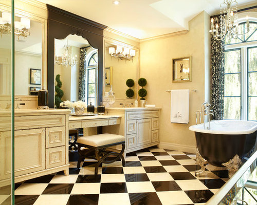 large traditional master black and white tile claw foot bathtub idea in toronto with distressed
