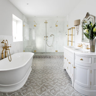 Large victorian ensuite bathroom in Surrey with grey cabinets, a freestanding bath, white tiles, stone tiles, grey walls, mosaic tile flooring, marble worktops, recessed-panel cabinets, an alcove shower, a submerged sink and a hinged door.