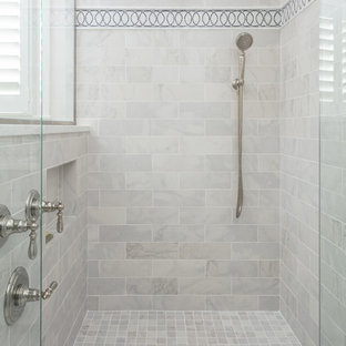 Example of a large classic master gray tile and marble tile marble floor and gray floor corner shower design in Boston with gray walls and a hinged shower door