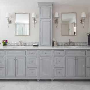 Inspiration for a large timeless master gray tile and mosaic tile marble floor and gray floor bathroom remodel in Boston with gray cabinets, gray walls, an undermount sink, flat-panel cabinets, a two-piece toilet and quartz countertops