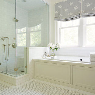 Example of a country master subway tile yellow floor bathroom design in Richmond with white cabinets, white walls and a hinged shower door