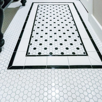 Example of a mid-sized classic master white tile and ceramic tile ceramic tile doorless shower design in Dallas with a console sink, flat-panel cabinets, black cabinets, marble countertops, a one-piece toilet and gray walls