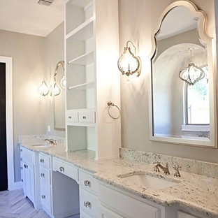 Bathroom - large craftsman master brown tile and ceramic tile concrete floor bathroom idea in Austin with furniture-like cabinets, white cabinets, a two-piece toilet, white walls, an undermount sink and granite countertops