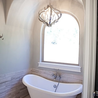 Inspiration for a large craftsman master brown tile and ceramic tile concrete floor bathroom remodel in Austin with furniture-like cabinets, white cabinets, a two-piece toilet, white walls, an undermount sink and granite countertops