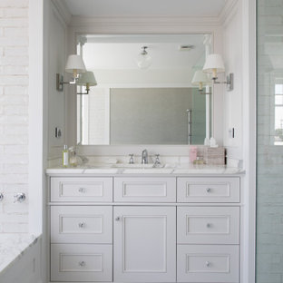 Photo of a traditional bathroom in Brisbane with white cabinets, an undermount tub, mosaic tile floors, marble benchtops, a built-in vanity, recessed-panel cabinets, a curbless shower, an undermount sink, white floor, white benchtops and a single vanity.