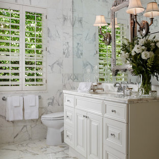 Large elegant master white tile and marble tile marble floor and white floor bathroom photo in Miami with raised-panel cabinets, white cabinets, gray walls, an undermount sink and marble countertops
