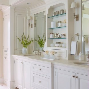 Traditional bathroom in New York with raised-panel cabinets and white cabinets.