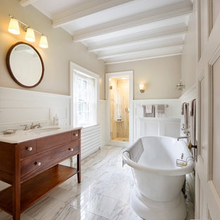 Elegant white tile and stone tile bathroom photo in Boston with an undermount sink, medium tone wood cabinets, marble countertops and flat-panel cabinets