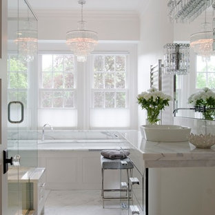 Large transitional master marble tile marble floor bathroom photo in Boston with a vessel sink, glass-front cabinets, white walls and marble countertops