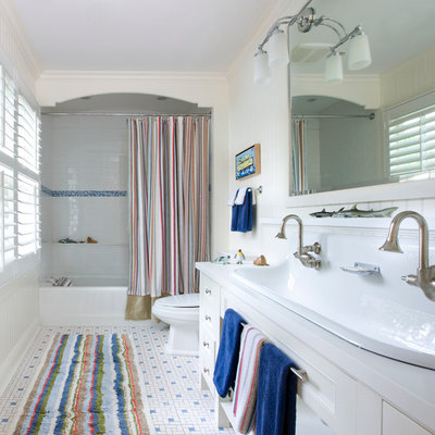 Example of a large trendy kids' mosaic tile and white tile mosaic tile floor bathroom design in Chicago with a drop-in sink, recessed-panel cabinets, white cabinets and white walls