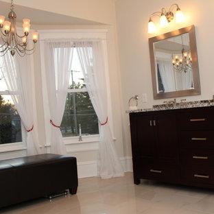 Immagine di una grande stanza da bagno padronale chic con ante in legno bruno, top in granito, piastrelle bianche, ante in stile shaker, doccia doppia, piastrelle a specchio, pareti bianche, lavabo sottopiano, pavimento bianco e porta doccia a battente