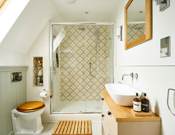 Classically styled small bathroom with tongue and groove panelling