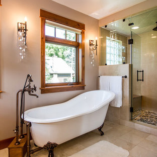 Clawfoot soaking tub with freestanding faucet and steam shower in master bathroo