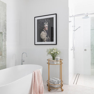 Large transitional master bathroom in Brisbane with shaker cabinets, white cabinets, a freestanding tub, an open shower, a one-piece toilet, white tile, porcelain tile, white walls, ceramic floors, an undermount sink, engineered quartz benchtops, pink floor, a sliding shower screen and white benchtops.