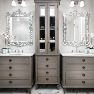 Inspiration for a large transitional master white tile and subway tile ceramic floor and multicolored floor bathroom remodel in Denver with flat-panel cabinets, gray cabinets, an undermount sink, beige walls, marble countertops, a hinged shower door and multicolored countertops