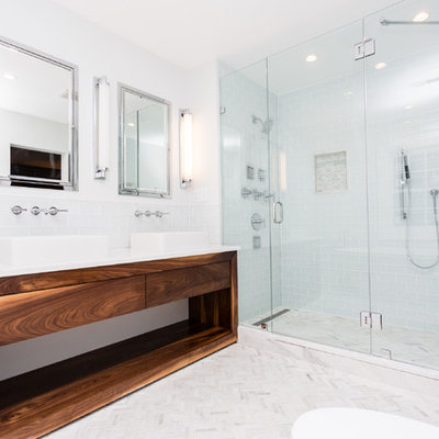 Trendy master white tile and subway tile mosaic tile floor freestanding bathtub photo in St Louis with open cabinets, medium tone wood cabinets, gray walls, a vessel sink and marble countertops