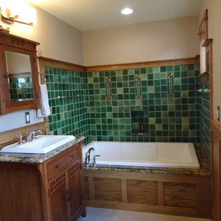 Inspiration for a large craftsman master green tile and ceramic tile ceramic tile bathroom remodel in Philadelphia with shaker cabinets, light wood cabinets, a one-piece toilet, multicolored walls, a drop-in sink and granite countertops