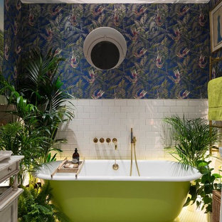 Photo of a bohemian ensuite bathroom in London with a freestanding bath, multi-coloured walls, white tiles and metro tiles.