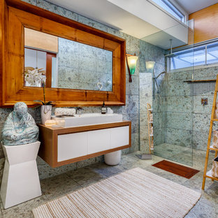 Inspiration for an asian master bathroom in Brisbane with light wood cabinets.